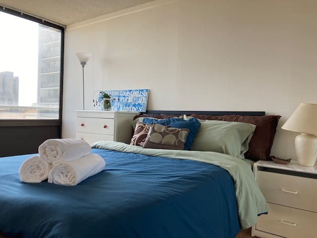 Large bedroom with queen bed and 2-inch thick foam mattress topper