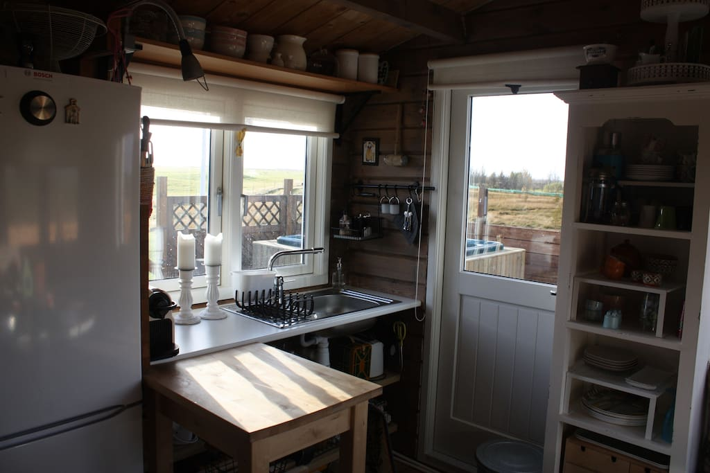 The kitchenette has a breath-taking view of the country side.