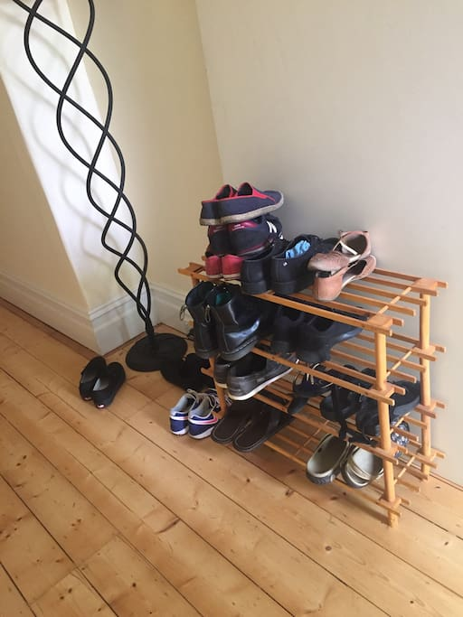 Shoes off please for skillful multi-tasking. As well as minimizing noise, it keeps tracked-in dirt to the doorways, provides a momentary pause before/after exit AND lightens the load by about 60% on the person responsible for the housework.