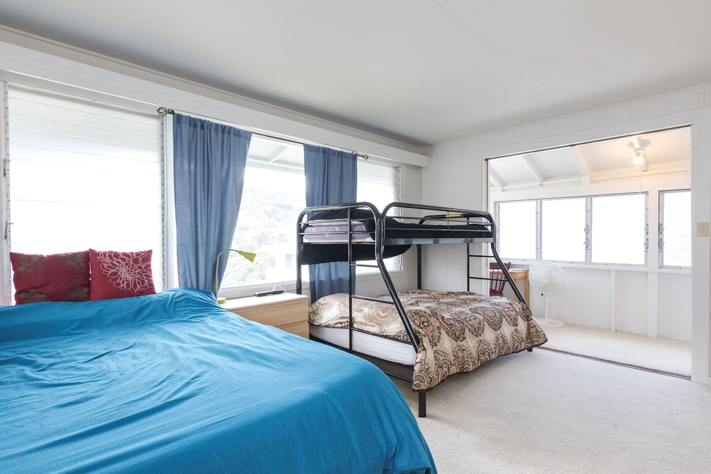 Huge master bedroom can comfortably sleep up to 5! Lots of windows to enjoy the natural sunshine!