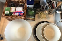 Basic kitchen equipment, plates, glasses, mugs, coffee and tea compliment from house