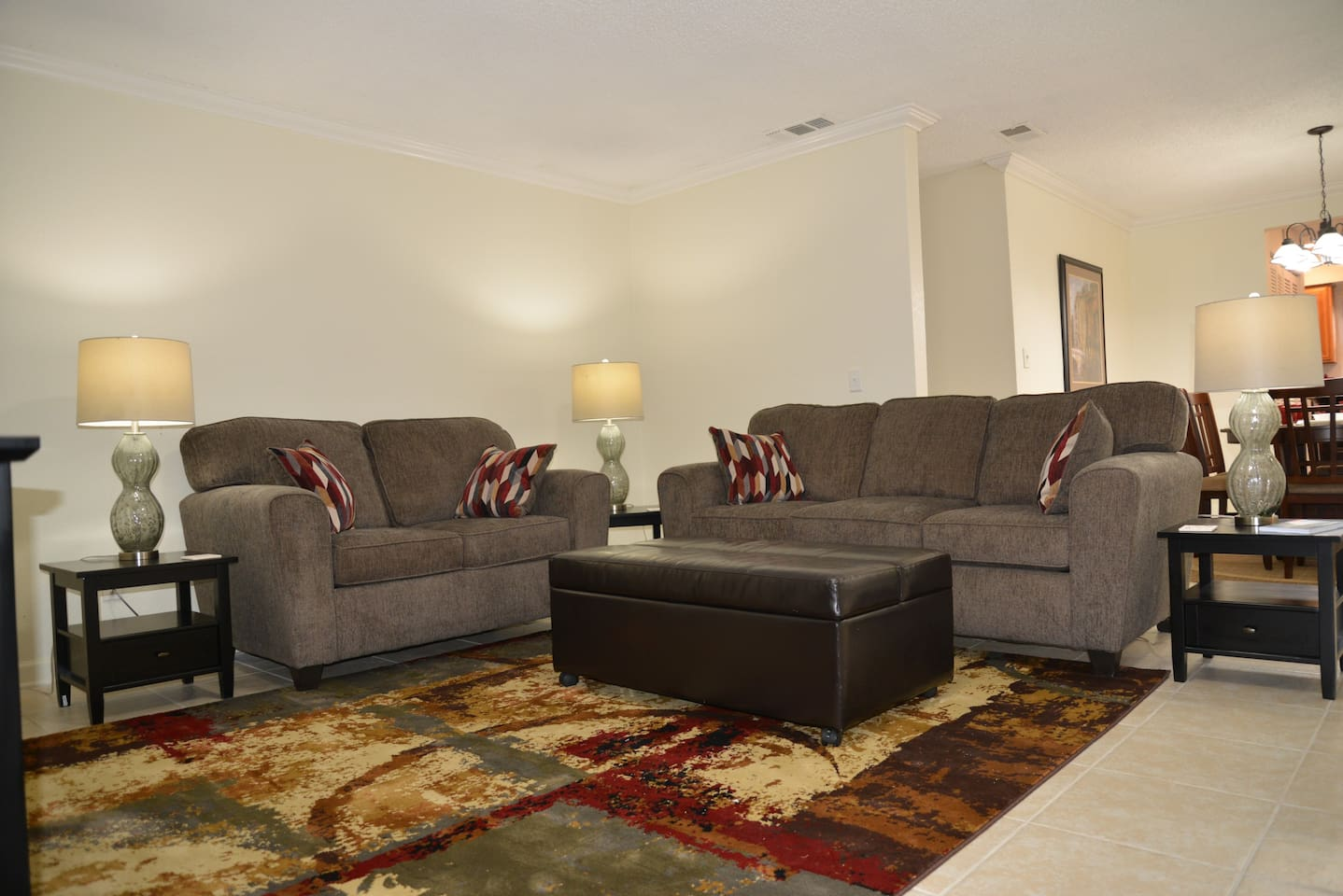 Living room - ottoman folds out into a twin bed which can be rolled into the master bedroom or the queen bedroom if needed