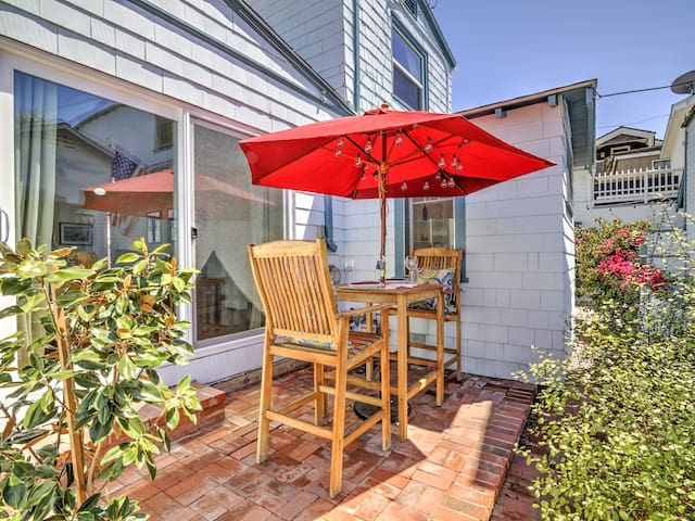 Dine alfresco on the back patio, just outside the living area, with outdoor seating for 2.