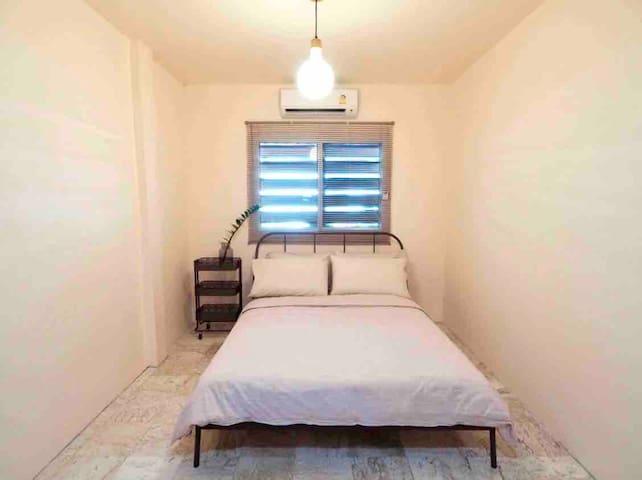 Room No. 5 Bed,  Pastel pink wall