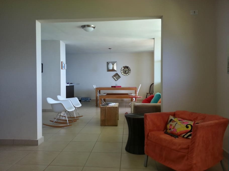 Open concept with family room, living room and dinning room all with ocean view.