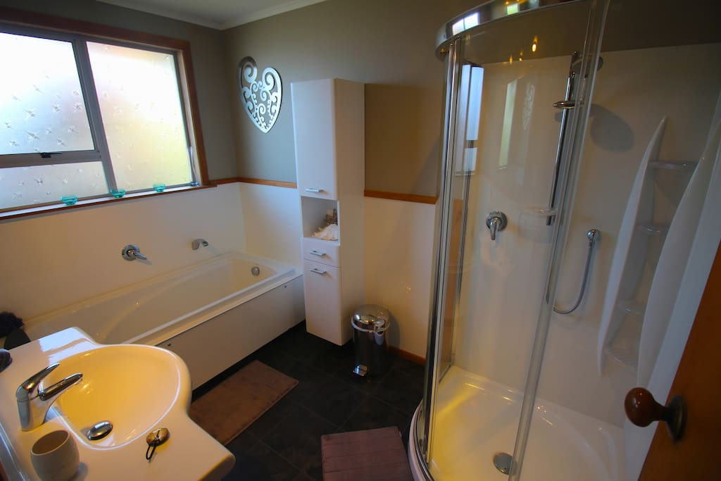 Guest bathroom with seperate toilet.