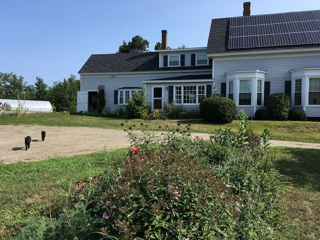 We live on the first floor of the farmhouse.  The guest suite is the entire second floor- with a private entrance using the front door that faces the street.