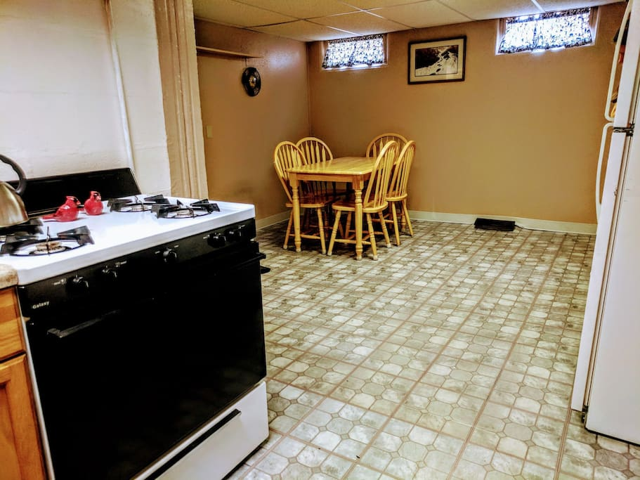 View of dining room. Also shown is gas burning stove/oven.