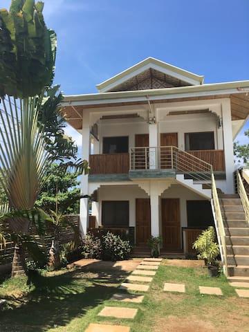 Cheap, clean and quiet rooms near Alona Beach