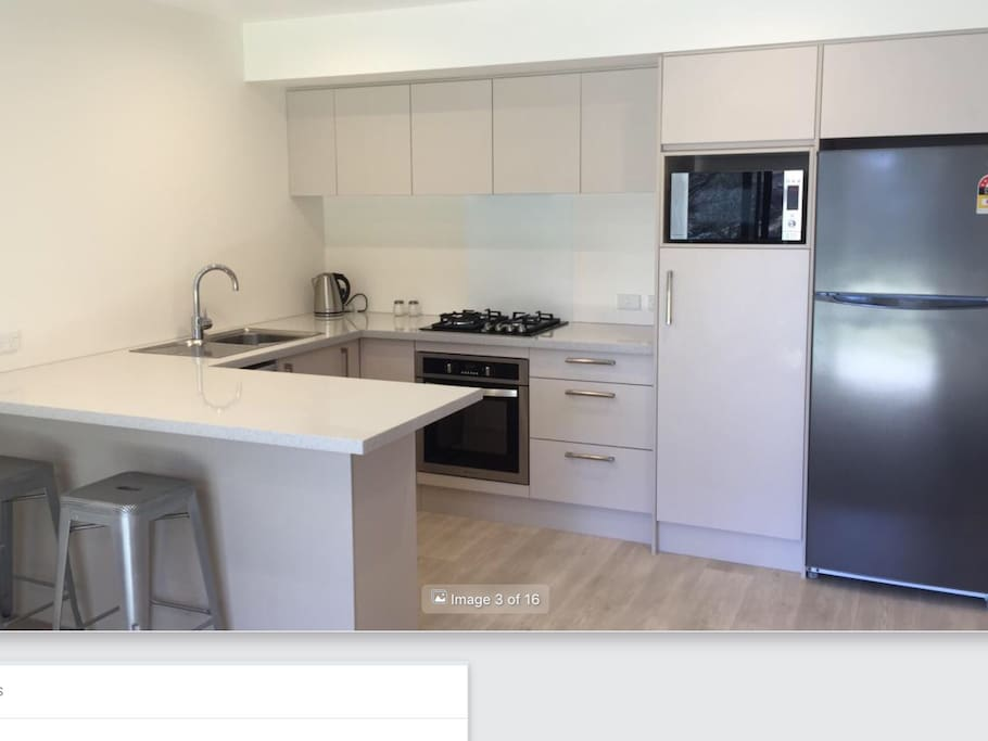 Kitchen has gas range, dishwasher, microwave, oven and refrigerator.