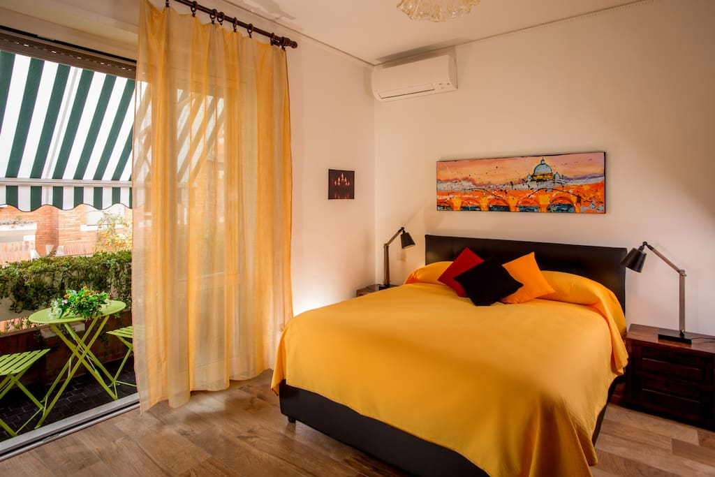 Bedroom with air conditioned, big door window and awnings