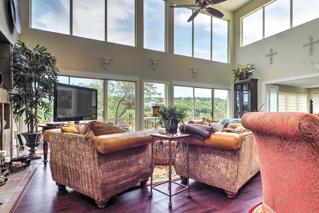 Expansive windows lend magnificent lake views throughout the home.