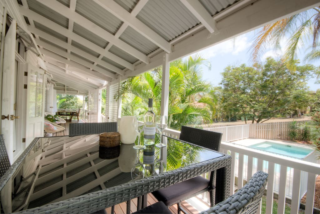Pool view from verandah, showing both outdoor dining areas
