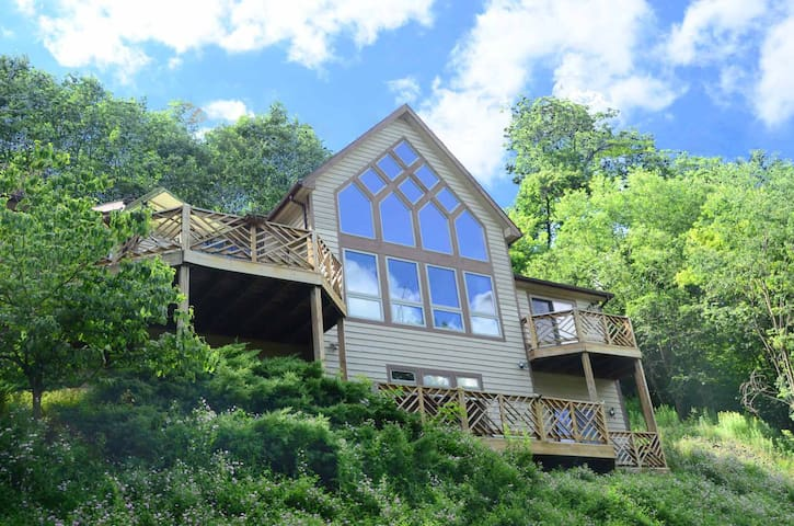 Split lake front home with private dock, foosball table and hot tub!