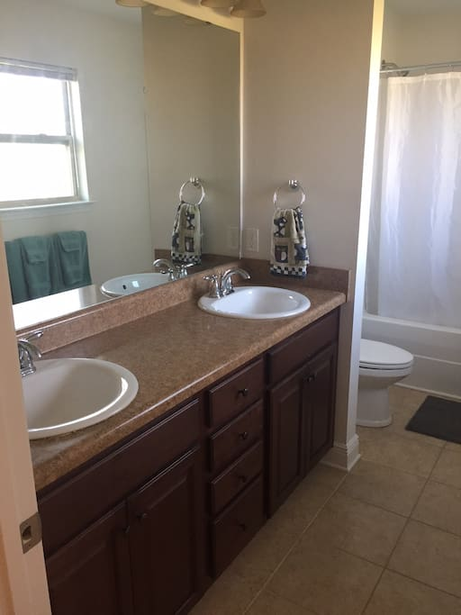 Clean bathroom. Shower/tub. Double sinks.