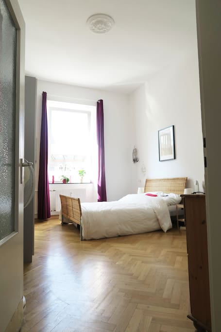 """Large bedroom with Alt Bau/Old House tall ceilings and centre """"stuck"""""""