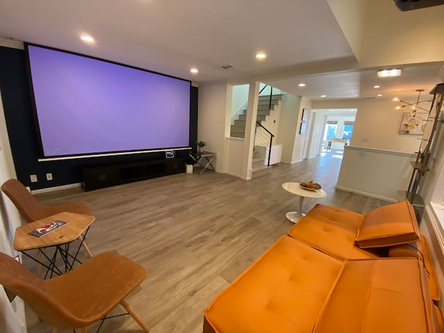 Main living room: brand new designer couch, huge projector screen for you to relax and enjoy.