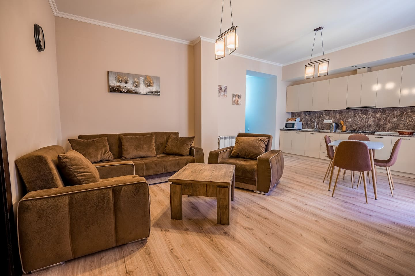 Lounge to relax at best with comfortable sofas and large screen tv, coffee table and wardrobe if needed.