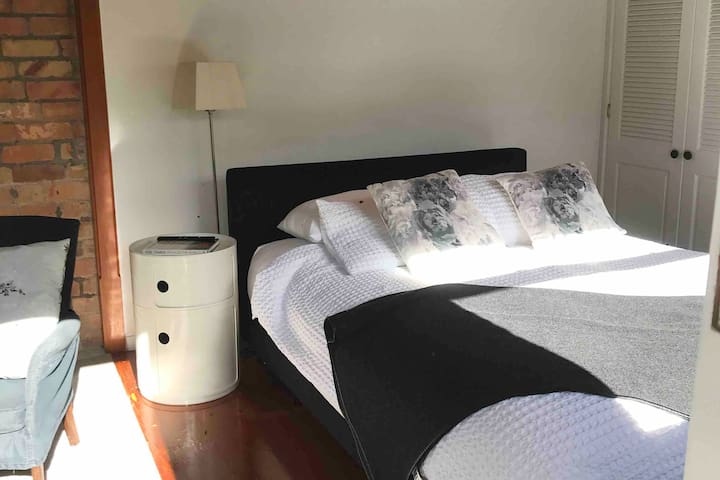 Kartell Camponabili bedside cabinet, Italian bed, nz made latex mattress, feather topper... Simply comfort.