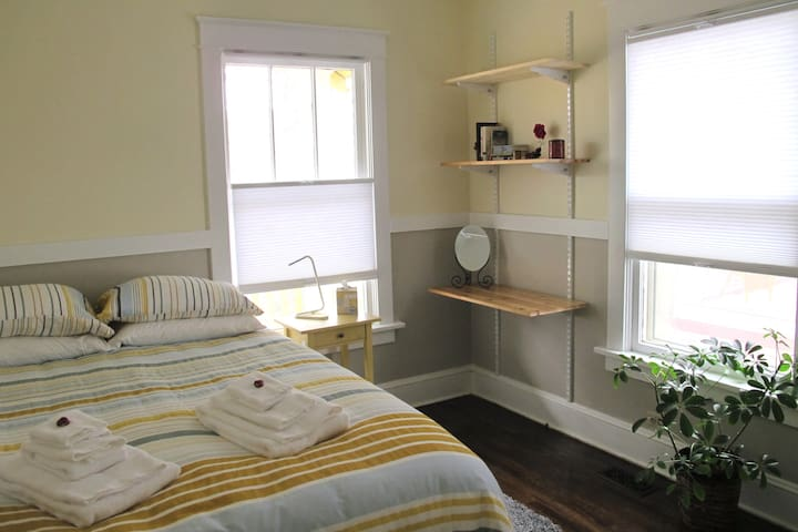 The Yellow Bedroom is bright and cheery.