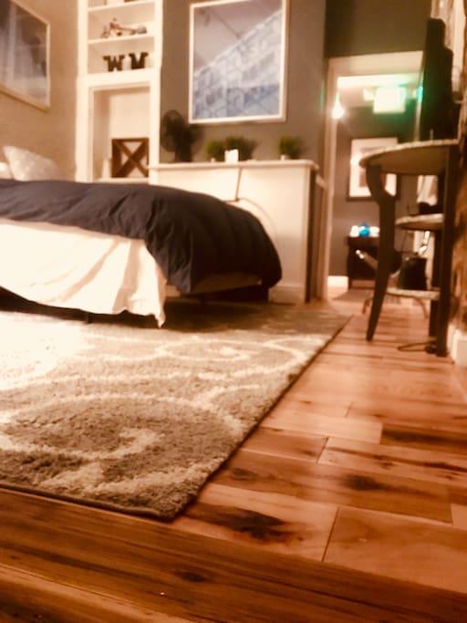Exotic hardwood flooring w 5 inch planks.