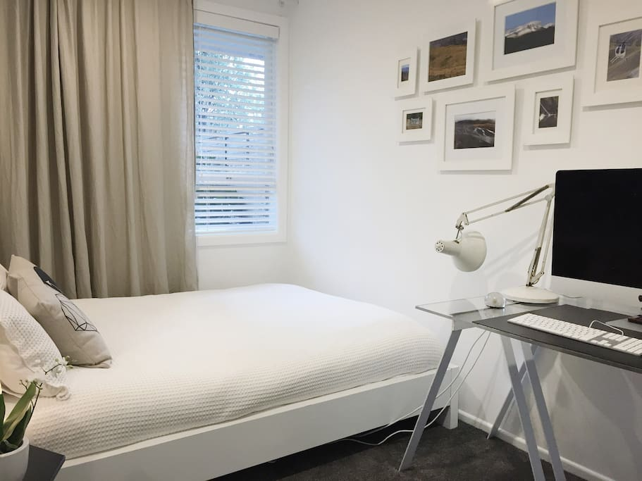 guest room is small but perfectly formed: queen bed, desk and wardrobe