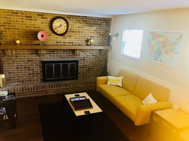 Warm travel themed apt that is relaxing in a comfortable living area w/a new convertible sofa (double bed) that pushes forward & lays back. It sleeps 2, however may be more comfortable for 2 kids or 2 small adults. Also a 55 inch TV in living area.