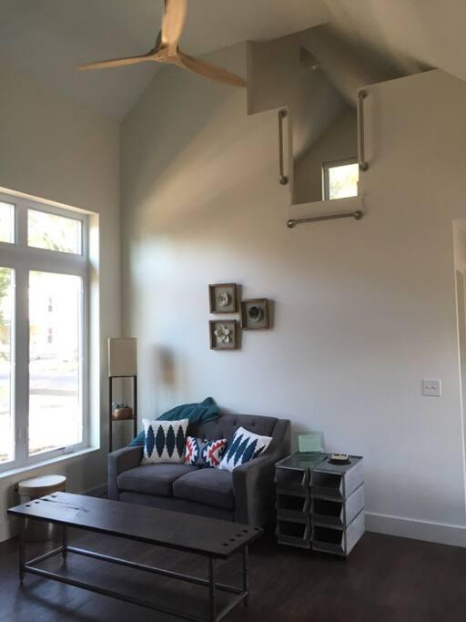 Main living area with loft (access via ladder).
