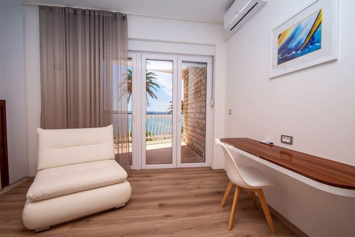 Bedroom No1 with double bed, sofa bed, balcony, ensuite bathroom