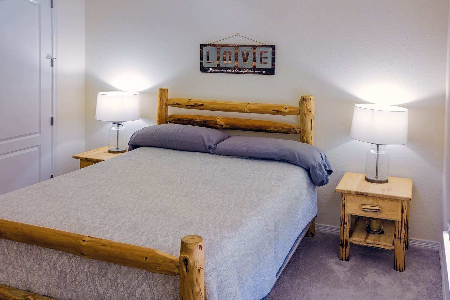 The Bedroom: comfortable Queen sized bed with end tables and lamps, walk-in closet (hangers provided)