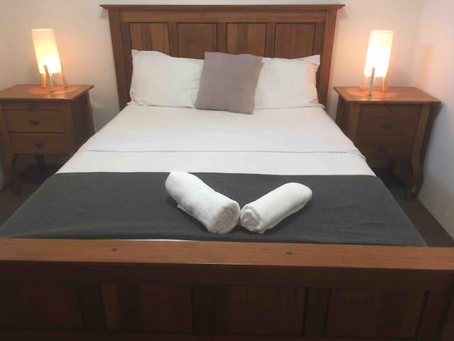 Luxurious double queen size bed in second bedroom.