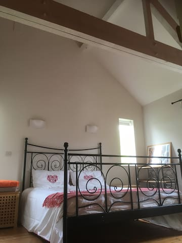 Upstairs, one of the double aspect cathedral ceiling bedrooms; this one has a full size ensuite.