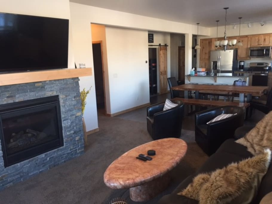 Open Living Space with seating for 8 at the table, plus 4 bar stools.   Queen sleeper sofa is also available.