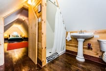 The attached private bath is a generous size and shows off the original trim and Douglas Fir floors. Amenities: shampoo & conditioner, bath soap, hand soap, make-up mirror and hairdryer. Rooms are also outfitted with: Steam iron and ironing board.