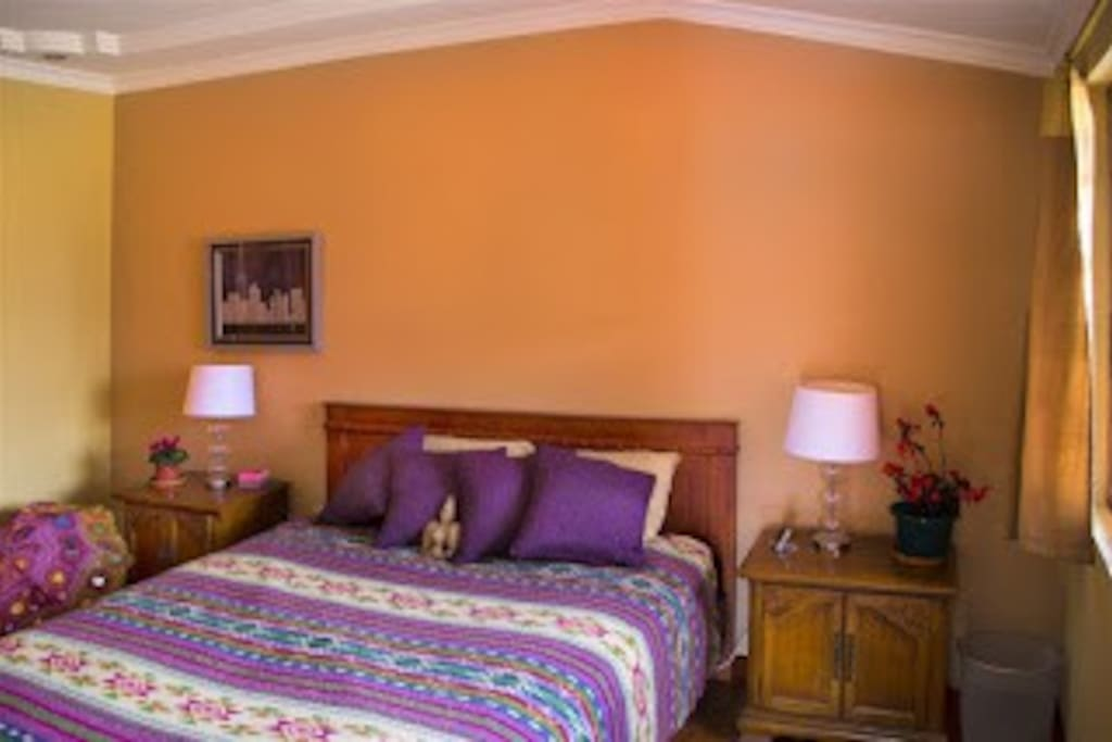 This is the bedroom with a queen bed, private bath, and closet storage.
