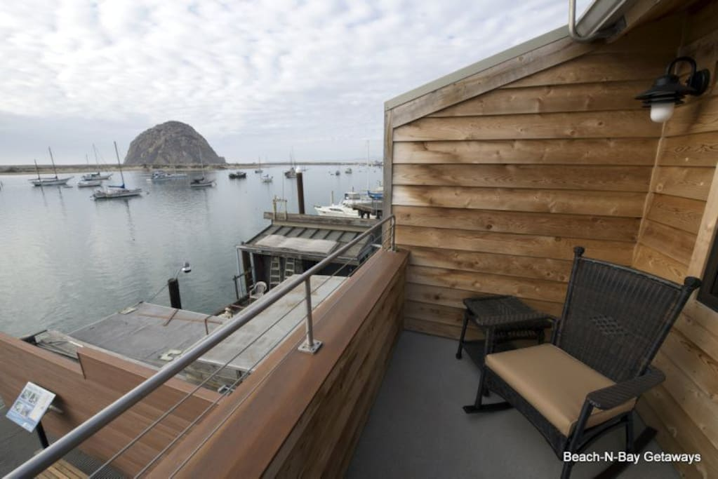 From the deck, you look across the bay to amazing views of the rock.  The deck includes a Weber grill and comfortable seating.