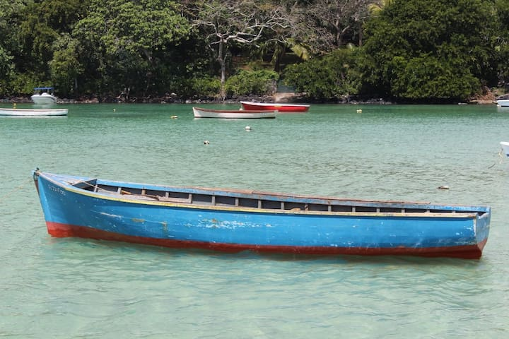 Boat in fishing village. 7-10 minutes walk from SM Lodge