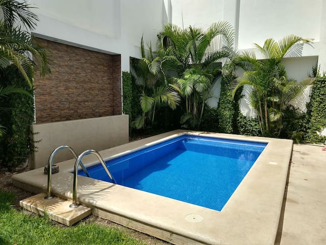 Perfect in town location with pool!