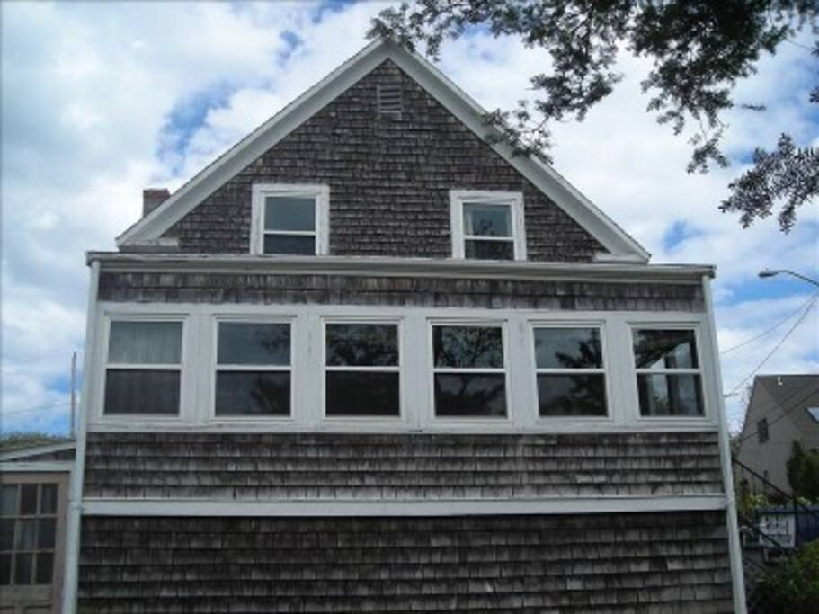 Bay-side view of house from driveway