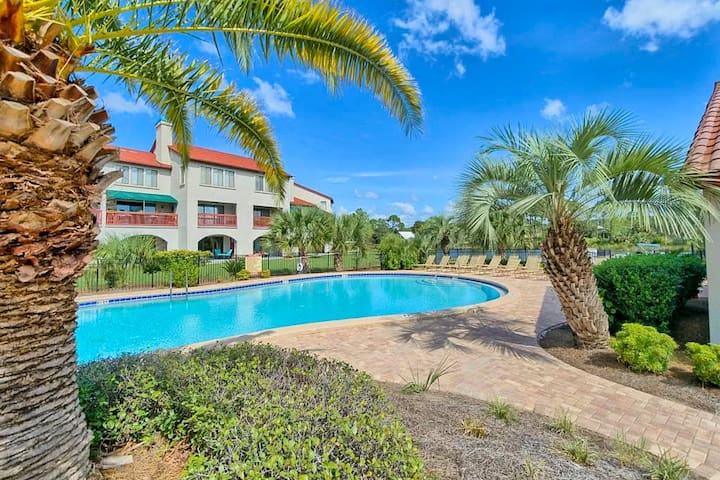 Cute beachy condo with private balcony, shared pool, and boat dock!