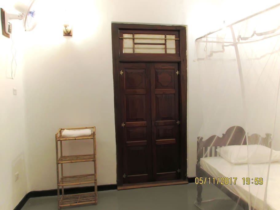 The bedroom with Double size bed interconnects to a second bedroom with a Queen size bed
