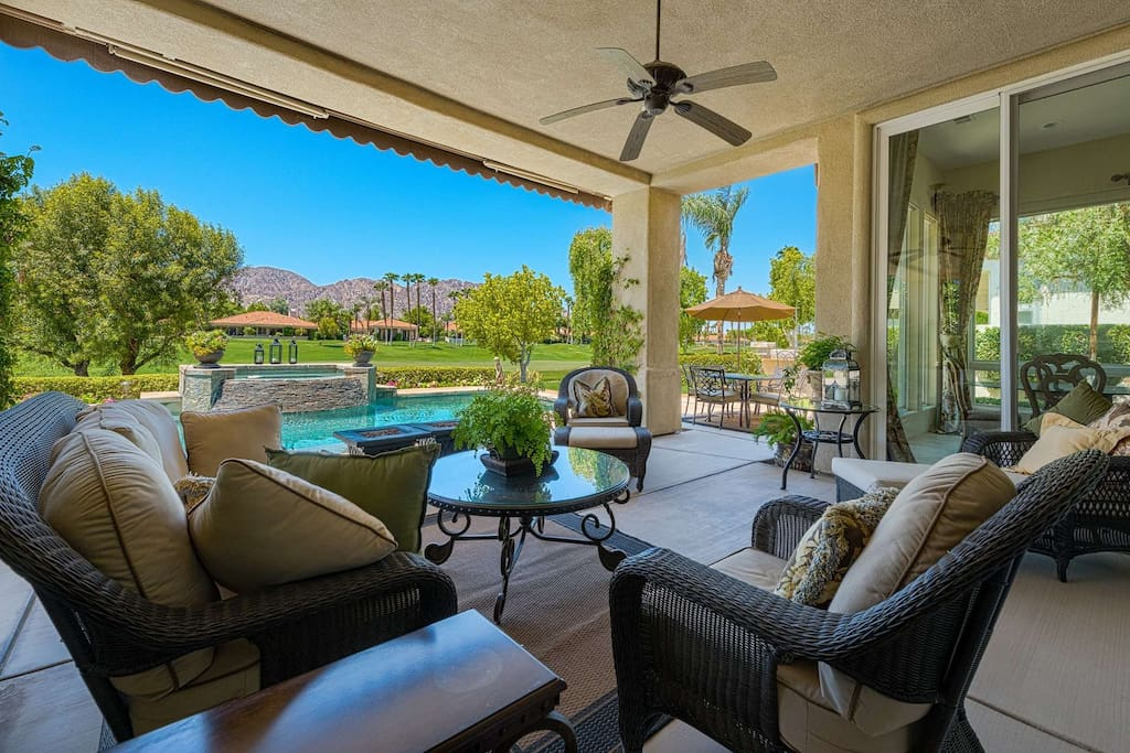 Luxurious Patio Seating with Views of the Pool, Golf Course and Mountains