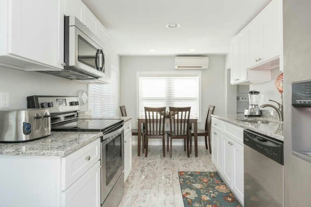 Kitchen: Gourmet kitchen with granite countertops stocked with every kitchenware you could imagine.