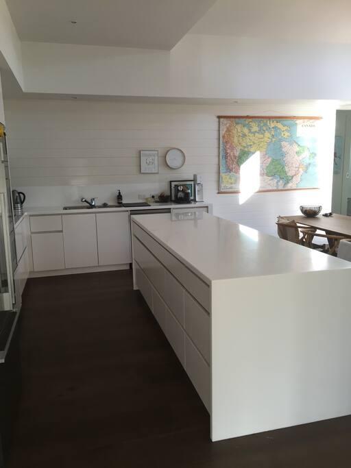 Spacious open plan kitchen with island bench