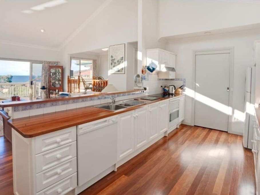 Large open plan kitchen with ocean views