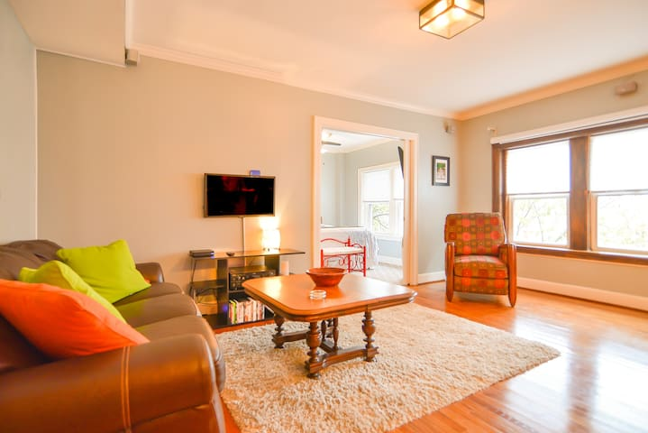 Light and vivid color to excite the senses.  Televisions in living room and bedroom