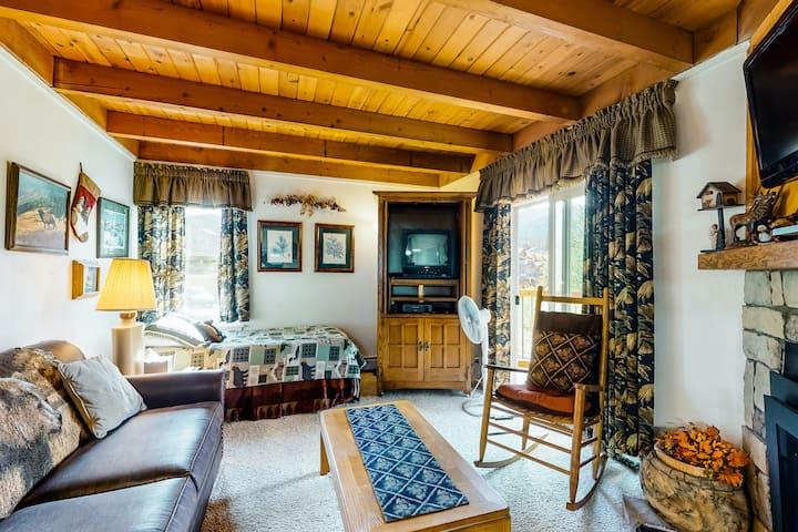 Warm condo with mountain views, free WiFi, full kitchen, and ski shuttle access!