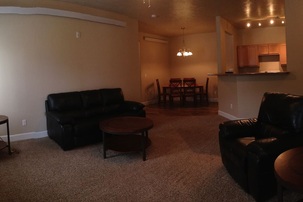 Panorama view of the living room, dinning and kitchen from the front door.