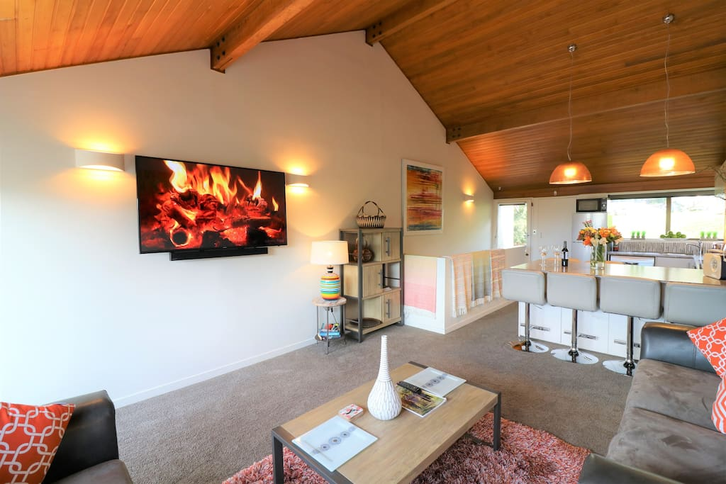 Spacious lounge well lit with 60inch  Ultra HDMI TV