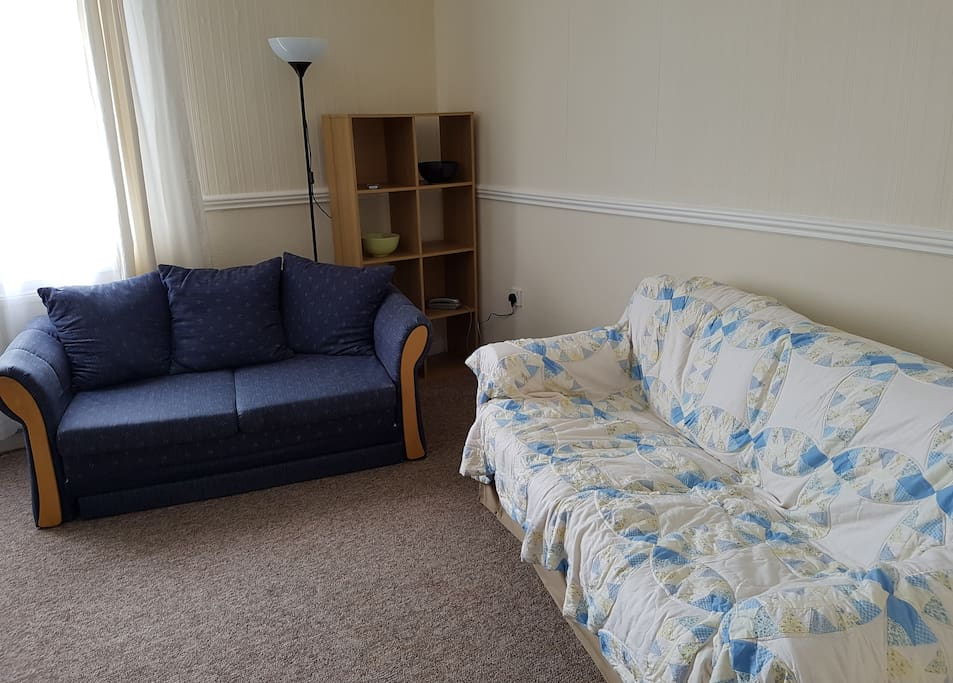 Bright comfortable front room with two sofas